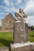 Celtic gravestone and church ruins