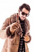 picture of hustler  - a young and rich man wearing a sheepskin coat isolated over a white background holding a cigar - JPG