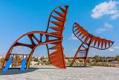 ASHKELON, ISRAEL - JUNE 26, 2010: Whale Tails - modern architectural composition designed by sculptor Aarele Ben Arieh in 2010 located on promenade along  seashore in popular tourist city of Ashkelon.