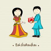 Brother giving gift to his sister on occasion of Raksha Bandhan festival.