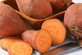 detail of batata sweet potatoes and kitchen knife