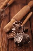retro kitchen cookies mould utensils tools on old wooden table in rustic style