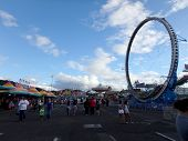People Walk Around With Rides Surrounding Them At The Hawaii's Annual 50Th State Fair