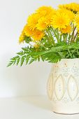 Bouquet Of Dandelions In A White Jug