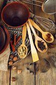 Retro kitchen utensils for baking on rustic wooden background