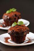 Yummy chocolate cupcake on table