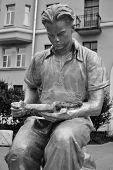 Sculpture - A Young Man Reading A Book.