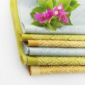 Stack Of Thai Fabric And Bougainvillea Flowers