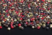 Red, Black, Green And White Peppercorns