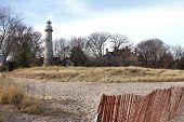 stock photo of gross  - Grosse Point Light House on the shore of Lake Michigan in Evanston - JPG