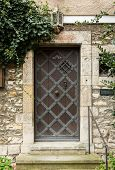 picture of ironclad  - Iron clad wooden entrance door in the medieval town of Regensburg Bavaria Germany - JPG