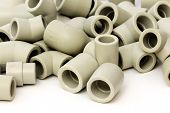 stock photo of thermoplastics  - A lot of combined fittings for plastic pipes on white - JPG