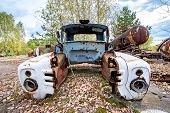 pic of junk-yard  - rusty wreck on junk yard near Illinci village in Chernobyl Nuclear Power Plant Zone of Alienation Ukraine - JPG