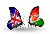 Two Butterflies With Flags On Wings As Symbol Of Relations Uk And Niger