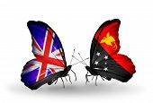 foto of papua new guinea  - Two butterflies with flags on wings as symbol of relations UK and Papua New Guinea - JPG