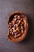 image of pinto bean  - Pinto beans in an olive wood dish - JPG