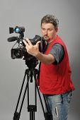 Cameraman in red vest,