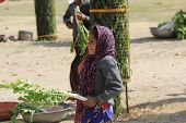Young Indian Girl Selling Vegetables