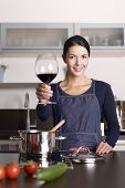 Smiling Young Housewife Celebrating With Red Wine