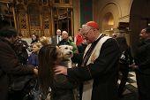 Cardinal Dolan greets pet owner