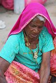 old Indian woman with a pink veil