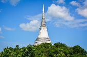 Temple thai on mount against blue sky background