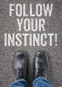 Text on the floor - Follow your instinct