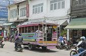 Phuket Town, Thailand - Sept,18 2014:City bus on the streets of the old town. Phuket Town, Thailand