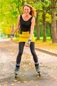 Portrait Of Laughing Slim Girl On Roller Skates