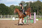 Brunette Woman Riding Playful Chestnut Horse