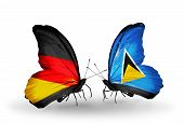 Two Butterflies With Flags On Wings As Symbol Of Relations Germany And Saint Lucia