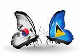 Two Butterflies With Flags On Wings As Symbol Of Relations South Korea And Saint Lucia