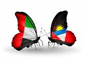 Two Butterflies With Flags On Wings As Symbol Of Relations Uae And Antigua And Barbuda