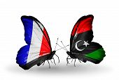 Two Butterflies With Flags On Wings As Symbol Of Relations France And Libya