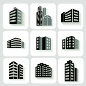 Set of dimensional buildings icons in grey and white with shadow depicting high-rise commercial   of