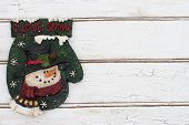 Christmas Background With A Christmas Mitten On Grunge Textured Wood Background