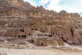 Ancient Houses On Facade Street In Petra Carved Out Of The Rock