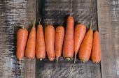 Carrots on wooden table background