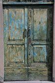 foto of wooden door  - close up old green wooden door peeling - JPG
