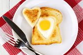 Valentines Day heart shaped egg and toast breakfast