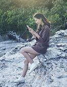 Young Beautiful Woman Connecting People By Smart Phone On Sea Side Location With Happy Face Use For