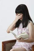 chinese girl reading horrible story