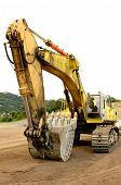 image of excavator  - A large tracked excavator at an construction site - JPG