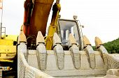 pic of track-hoe  - A large tracked excavator at an construction site - JPG