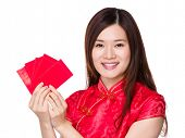 Chinese woman holding red pocket lucky money