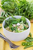 Pasta salad with farfalle, peas and feta