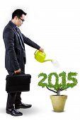 Businessman Nurture A Tree Shaped Number 2015