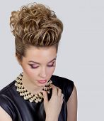 Beautiful young woman with evening make-up and salon hairdo Smoky eyes Complicated hairstyle