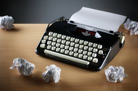 pic of storyboard  - Frustration stress and writers block with old typewriter on desk and crumpled paper ball - JPG