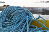 foto of nylons  - Pile of blue nylon rope in the harbor - JPG